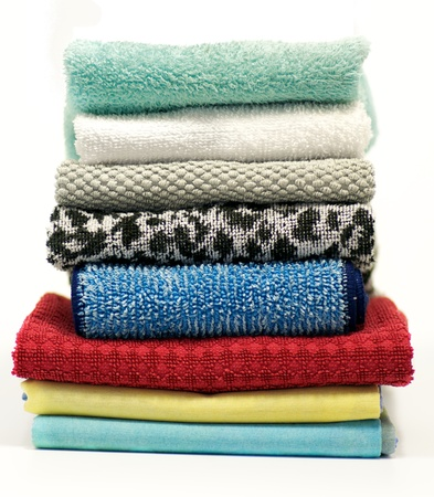 Colorful terry cloth towels isolated on white background photo
