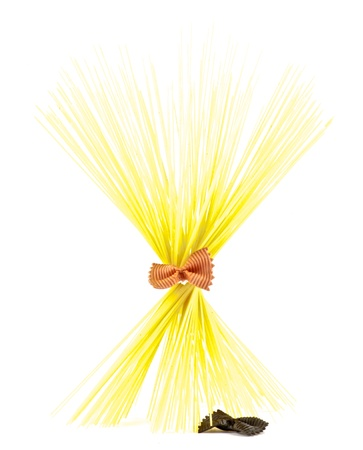 Bunch of spaghetti with red farfalle isolated on white background photo