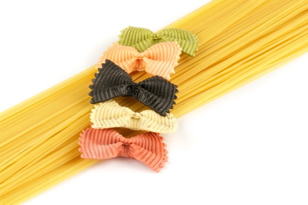 Italian pasta spaghetti and farfalle isolated on white background