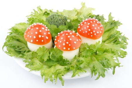 funny food: Fly mushroom formed from boiled egg, cover with the tomato mayonnaise  Funny food for children or party  Stock Photo