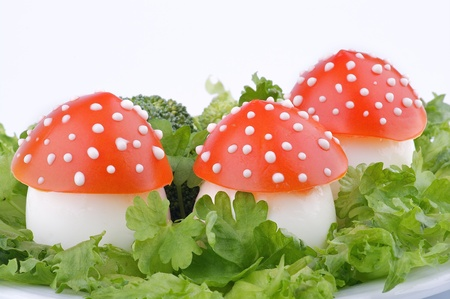 funny food: Fly mushroom formed from boiled egg, cover with the tomato mayonnaise. Funny food for children or party.