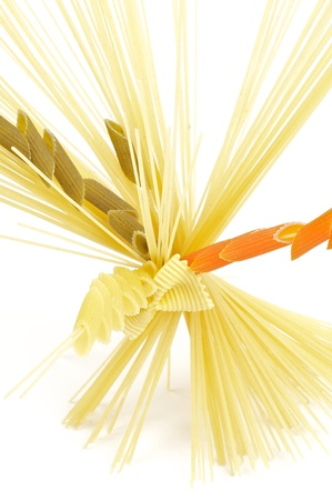Bunch of spaghetti with color fusilli isolated on white background photo