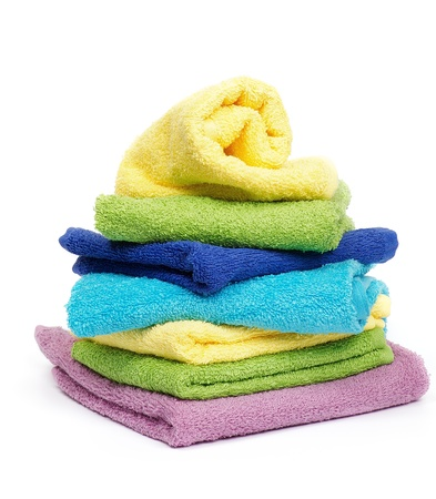 Multi-colored Terry towels isolated on white background photo