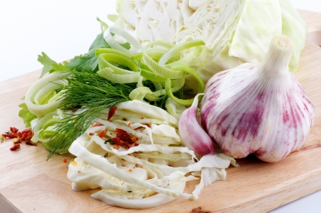 Set of cabbage and raw vegetables close up on wooden background Stock Photo - 13826872