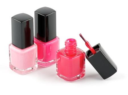 Three bright nail varnishs and brush isolated on white background Stock Photo - 13826863