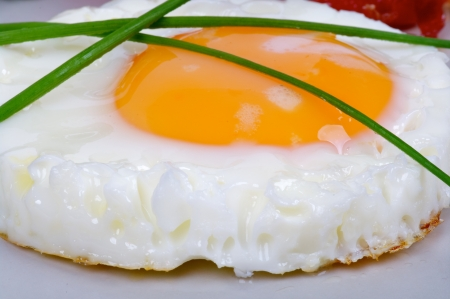 sunny side up: Fried Eggs Sunny Side Up with Onion closeup on gray plate