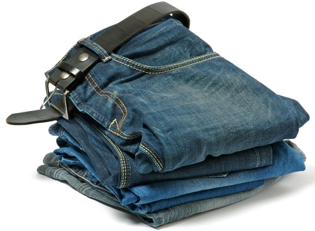 Stack of Old jeans and Belt isolated on white background photo