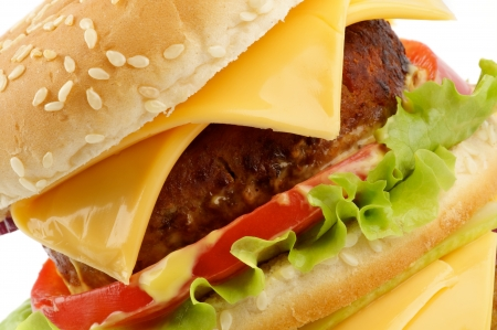 Tasty Cheeseburger with beef, tomato, lettuce and cheese closeup photo