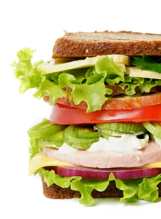 Tasty Lunch Sandwich with Bacon, Lettuce, Tomato, Cheese and Greens close up isolated on white background Stock Photo