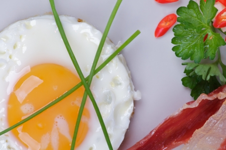 Fried Eggs Sunny Side Up with Bacon, Parsley and Lettuce photo