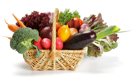 Basket of Various Vegetables with Broccoli, radishes, lettuce, onions, leeks, beets, carrots, red tomatoes, yellow tomatoes, parsley isolated on white background photo