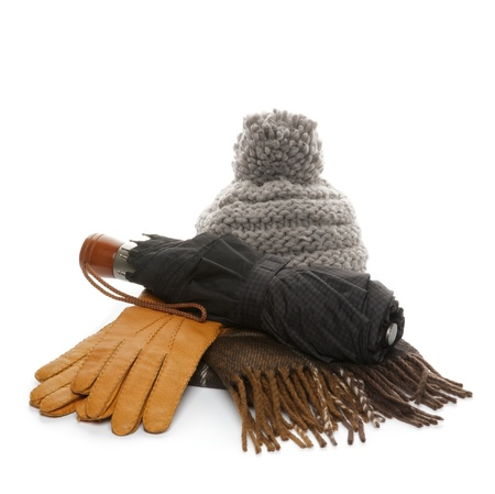 Arrangement of Autumn Accessories with Hat, Glove, Scraft and Umbrella isolated on white background photo