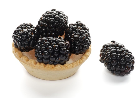 Cracker with Perfect Blackberries isolated on white background photo