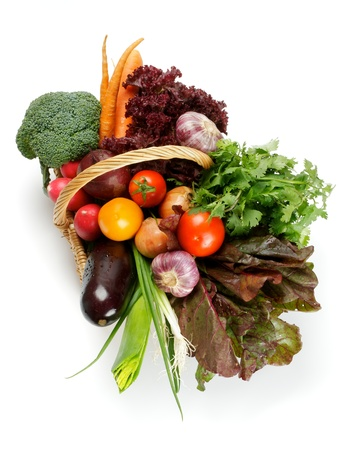Basket of Various Vegetables with Broccoli, radishes, lettuce, onions, leeks, beets, carrots, red tomatoes, yellow tomatoes, parsley top view isolated on white background