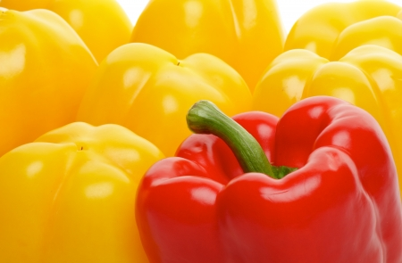 Background of One Red and Some Yellow Bell Peppers close up photo