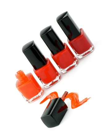 Four Bright Nail Varnishs and Spilled with Brush isolated on white background Stock Photo - 14965548