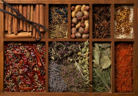 Nine Sections in Wooden Box with Mixed Spices, Herbs and Dried Leafs close up photo