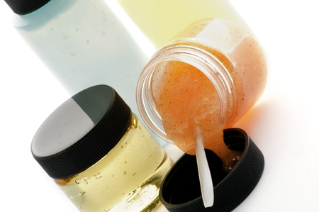 Arrangement of Facial Cosmetics with Apricot Scrub, Facial Cleanser, Facial Foam and Mousturizer in Containers isolated on white background