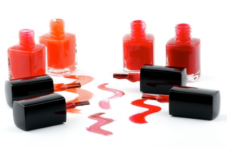 Four Bright Nail Varnishs and Spilled with Brushes isolated on white background Stock Photo - 14965551