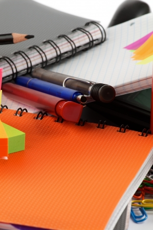suppliers: Office Suppliers with Pens and Ring Binder Notebooks close up