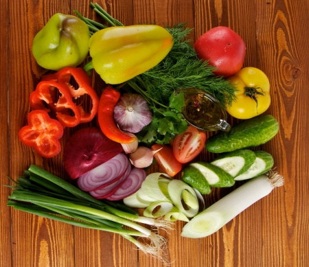 Ingredients of Vegetable Salad with Tomato, Cucumber, Onion, Leek, Dill, Parsley and Olive Oil top view on Wooden background Banco de Imagens - 15301179