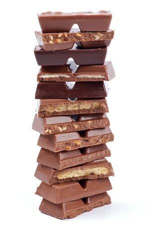 Stack of Various Chocolate Blocks isolated on white backgrounds photo