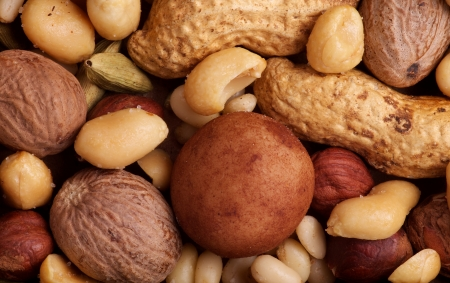 whole pecans: Background of Almonds, Brazil nuts, Cashews, Hazelnuts, Peanuts, Pecans, Pine nuts, Pistachios, Sesame seeds close up Stock Photo