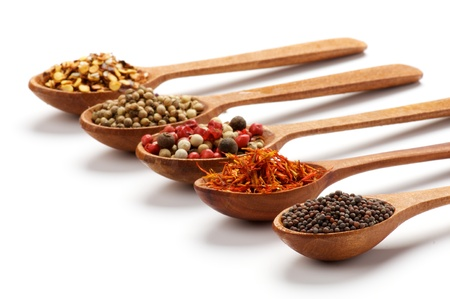 Five Wooden Spoons with Black Whole Grain Mustard, Saffron, Pepper, Coriander and Dried Chili isolated on white background