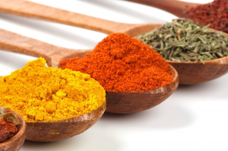 pepper flakes: Spices with Curry Powder, Oregano and Paprika closeup