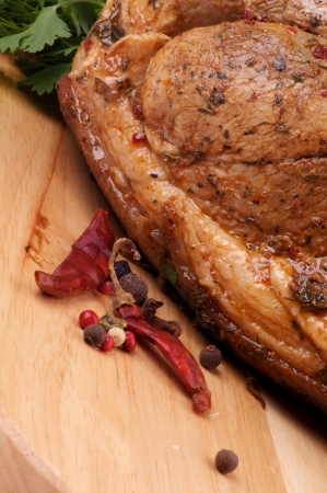 Ripe Spicy Roasted Pork with Herbs and Chili closeup on Cutting Board Stock Photo - 15725197