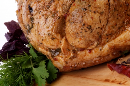 Glazed Spicy Roasted Pork with Herbs, Greens and Chili closeup on Cutting Board Stock Photo - 15808160