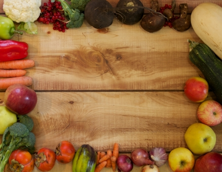 autumn harvest: Full Frame of Autumn Harvest with Fruits, Vegetables and Berries closeup on Wood background