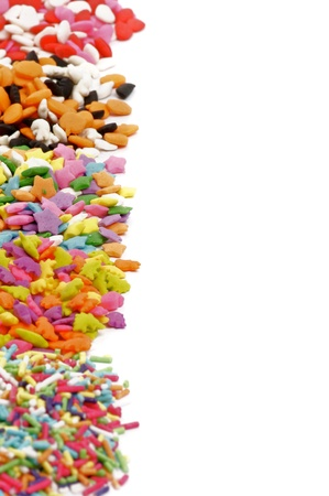 jimmies: Frame of Multi Colored Sprinkles  isolated on white background selective focus Stock Photo