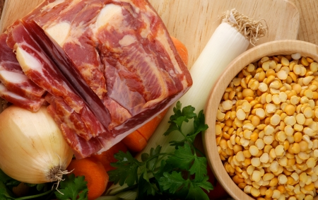 Ingredients of Pea Soup with Yellow Pea, Onion, Leek, Carrot, Parsley and Smoked Ham on Wooden Cutting Board closeup Stock Photo - 16406102