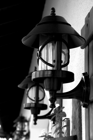 Wrought Iron Street Lamps Old-Fashioned on Building Wall outdoors photo
