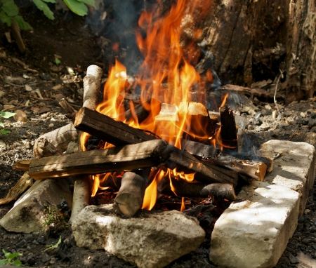 Camping Fire into Stones closeup outdoors Stock Photo - 16486189