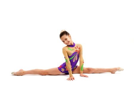 Young Girl Gymnast Do Splits on white background photo