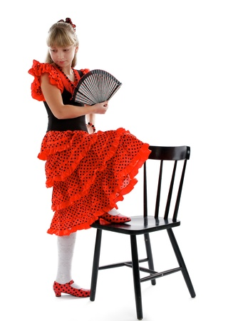 Young Girl in Posing of Flamenco  Traditional Costume and Fan photo