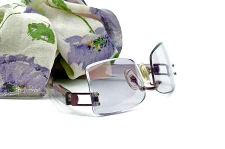 Contemporary Lilac Spectacles and Silk Scarf closeup on white background Stock Photo - 17174337