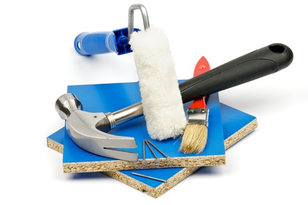repair tools: Repair Tools with Platen, Brush, Nails and Hammer on Blue Pieces of Fibreboard on white background