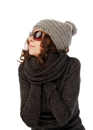 Beautiful Girl in Knitted Hat and Sunglasses Warms Hands into her Warm Sweater closeup on white background Stock Photo - 17347012