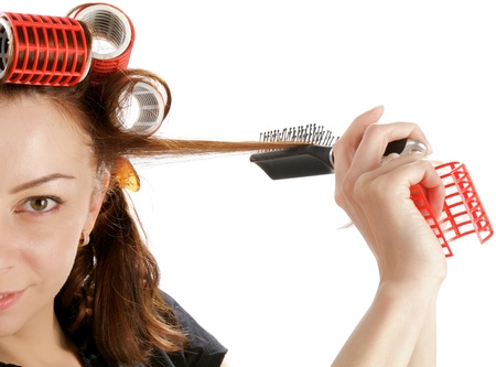 Young Attractive Woman Using Curlers with Hairbrush closeup on white background Stock Photo - 17347010