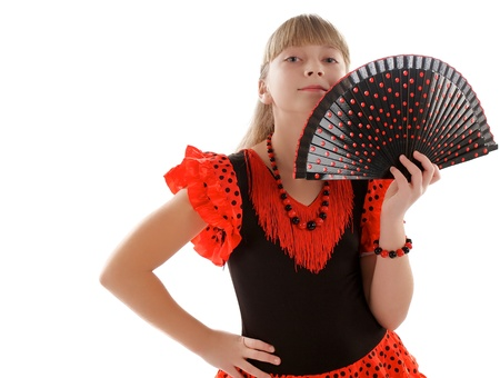 Young Girl Posing in Stance of Flamenco in Traditional Costume with Fan closeup on white background photo