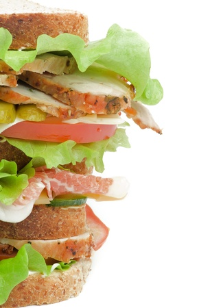 marinated gherkins: Tasty Turkey Meat Sandwich with  Cheese, Tomato, Bacon, Marinated  Gherkins and Lettuce on Whole Wheat Bread isolated on white background