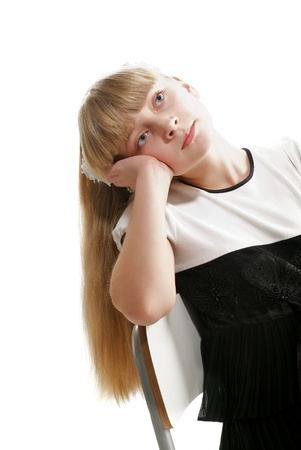 Beautiful Girl with Long Blond Hair Dreams closeup on white background photo