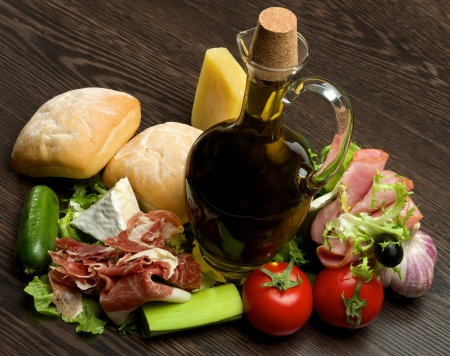proven: Proven Still Life with Vegetables, Hamon, Ciabatta, Cheese and Olive Oil closeup on Dark Wood background Stock Photo