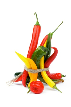 Bunch of Various Chili Peppers with Red Habanero, Green Jalapeño, Yellow Santa Fee, Green and Red Peppers isolated on white background photo