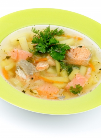 potato cod: Green Plate of Fish Soup with Salmon, Cod, Trout, Potato, Carrot decorated with Dill and Parsley closeup on white background Stock Photo