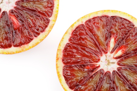 Two Blood Oranges in Half closeup on white background photo