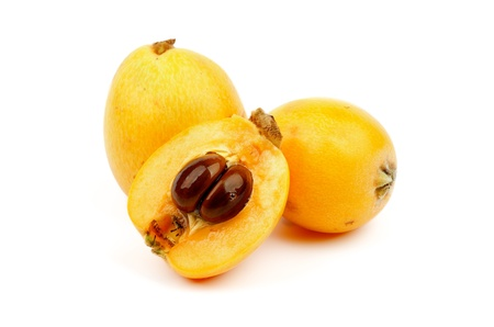 Heap of Loquat Medlar Fruit Full Body and Half of isolated on white background Stock Photo
